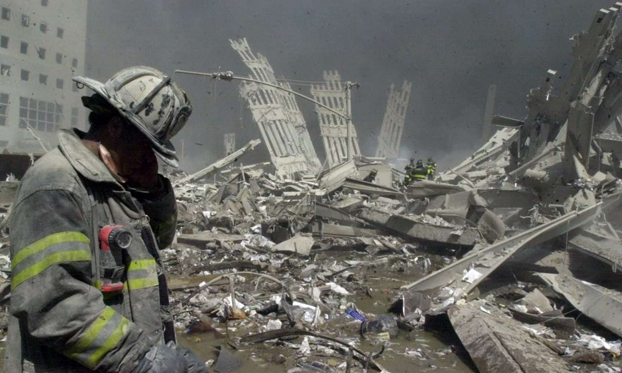 Firefighter walks through the rubble of the World Trade Center after it was struck by a commercial airliner in a terrorist attack. A hijacked American Airlines Boeing 767, originating from Boston's Logan Airport, struck 1 World Trade Center (north tower) at 8:45 a.m. At 9:03 a.m., a United Airlines 767, also hijacked in Boston, crashed into 2 World Trade Center (south tower).The second tower came down 39 minutes after the first. (Photo By: Todd Maisel/NY Daily News via Getty Images)